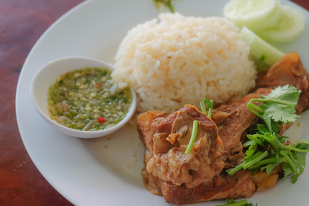 stew ribs with rice served in the plate
