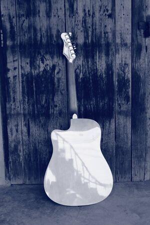 fluent: My favorite guitar and the old door. Stock Photo