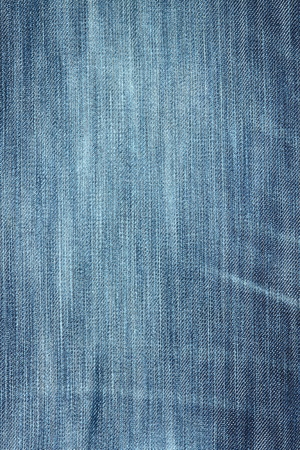 The image of  dark blue jeans fabric close up photo