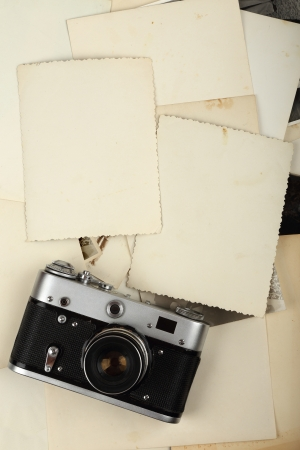 foto: Old camera against old photos Stock Photo