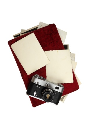 foto: Old camera and picture album with photos isolated on white background Stock Photo