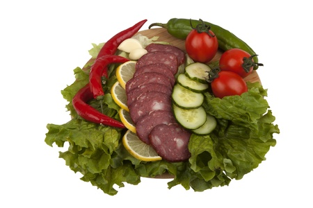 Sausage with vegetables on  kitchen board isolated on white background Stock Photo - 18459228