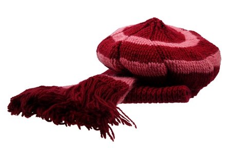 Knitted winter scarf and cap on white background photo