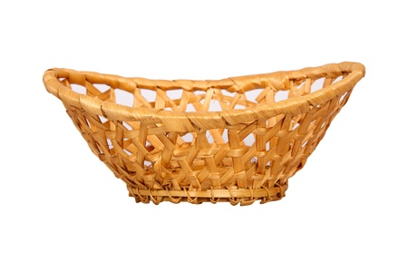 Wattled wooden basket isolated on white background photo