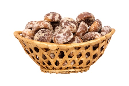 wickerwork: Basket with spice-cakes isolated on a white background