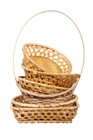 Wattled wooden basket set isolated on white background photo