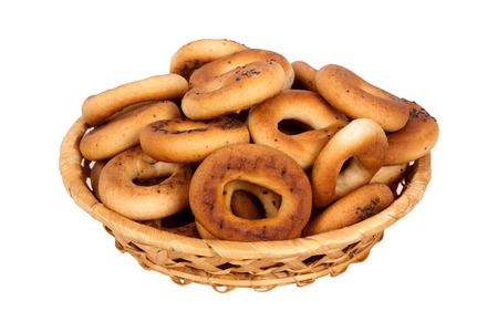 boublik: Basket with dry bread-ring  isolated on white background