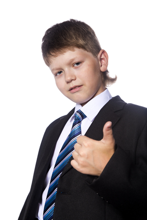 blazer: The portrait of the teenager in black jacket and a white shirt with tie showing thumb up, isolated on white background