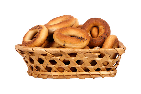 bublik: Basket with dry bread-ring  isolated on white background