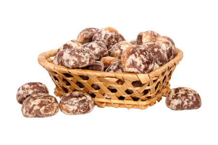 Basket with spice-cakes isolated on a white background