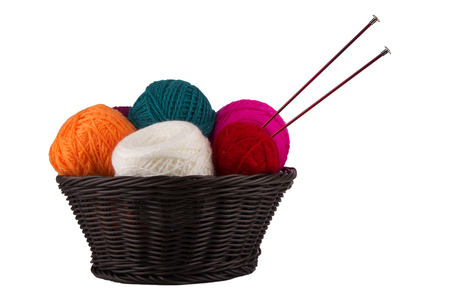 basket embroidery: Wattled basket with balls of threads for knitting and spoke isolated on white