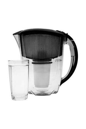 purifying: Pitcher with filter for water cleaning isolated on white