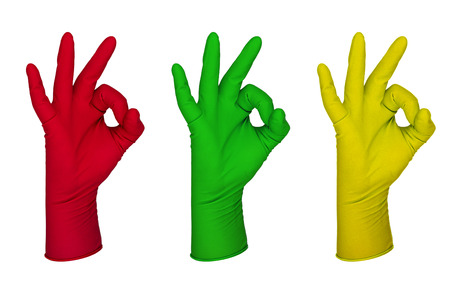 rubber gloves: Hand with latex glove various colours set isolated on white  Stock Photo