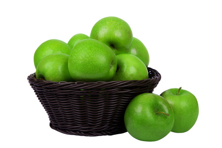 Basket with apples isolated on white background photo