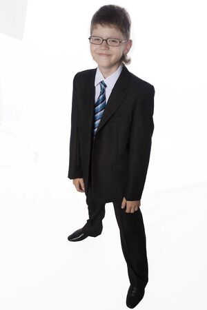 blazer: The portrait of teenager in black suit and a white shirt isolated on white backgrounddark Stock Photo