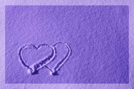 Heart drawn on the snow - composition with copy space, lettering template, text, design. Postcard template. The concept of the holiday.