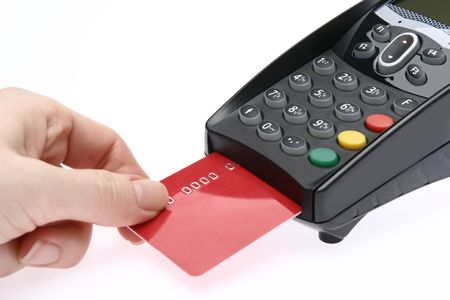 Swiping of the credit card for payment processing. Stock Photo