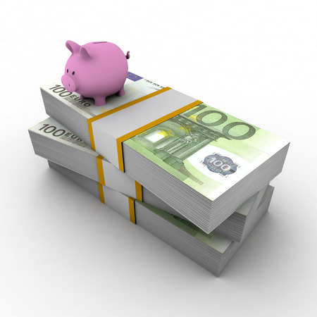 Piggy bank on top of pile of euro Stock Photo