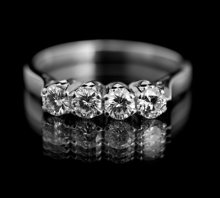 silver wedding anniversary: Jewellery diamond ring on a black background.