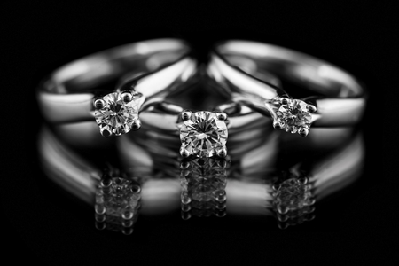 Jewellery diamond ring on a black background.