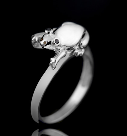 path to wealth: engagement ring on a black background Stock Photo