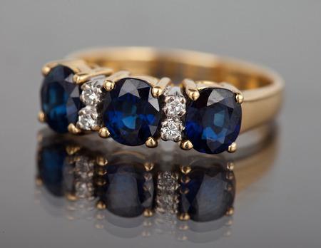 silver jewellery: Jewellery diamond ring on a gray background.