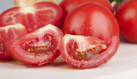 cantle: tomato on a kitchen wooden board