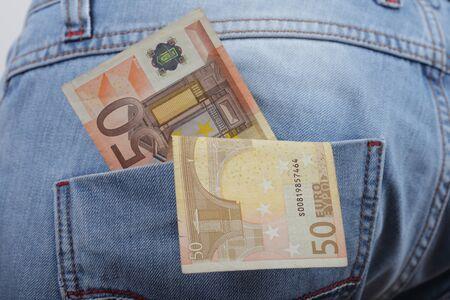 Euro banknotes in jeans back pocket