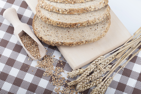 fresh bread and wheat on the wooden Zdjęcie Seryjne - 49028698