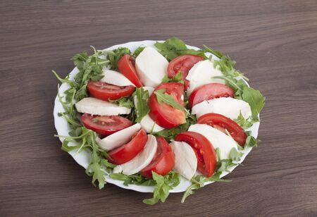 salad from arugula tomatoes and mozzarella.