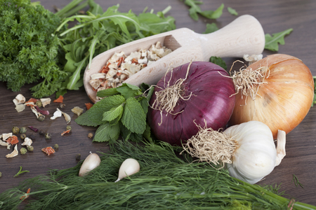 Herbs and spices on wooden background. Zdjęcie Seryjne