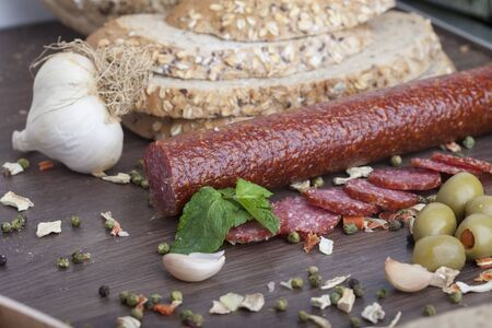 sausage cut into slices on a wooden board