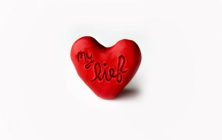 red clay: Red clay heart with my love engraved on white background Stock Photo