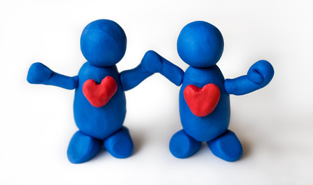 harmony united: Blue clay people holding hands, united in harmony