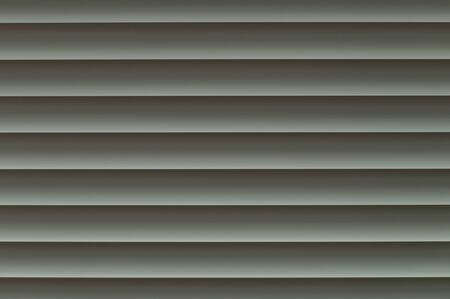 louver: Perfectly straightened and aligned with the concept of an infinite horizon. Different greyish shades from light white to light grey in a harmonicly balanced order invite us to slow down and relax our eyes for a second.