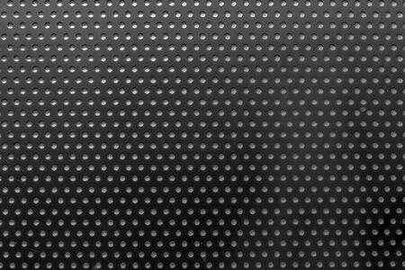 drilled: metal dot mask grid with drilled holes and decent traces of dirt from environmental pollution Stock Photo