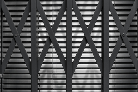 jalousie: Iron security fence in front of a jalousie used for protection Stock Photo