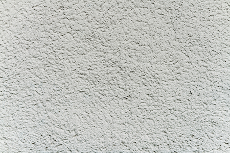 realism: perfect white grayish plastering wall structure background with intense texture creating an almost 3-dimensional effect can be used as a screensaver or to support specific authentic and realistic design Stock Photo