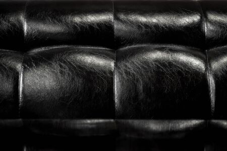 decent: close-up of a leather made sofa or sound reduction surface of highly symmetrical nature, decent background place to store virtual visual informations.