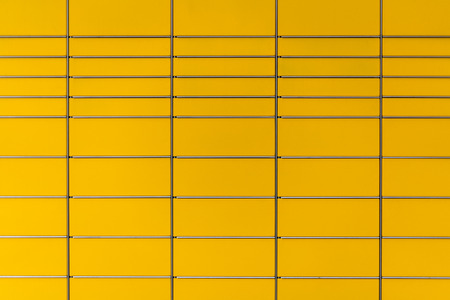 screensaver: Background of yellow colored post boxes or abstract screensaver with squares and simple graphic geometry