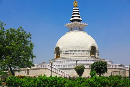 asian culture dome temple in india. closeup view of famous historical religious place. for nature surrounded greenery scenic attraction viewers.