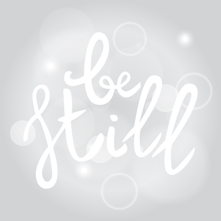 Be still Lettering phrase. Hand drawn motivation and inspiration quote. White letters on gray blured background. Artistic design element for poster, banner. Calligraphy print. Vector illustration.