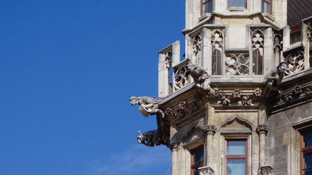 Detail of religious stone gargoyles on a tower in Munich, Germany Stock Photo