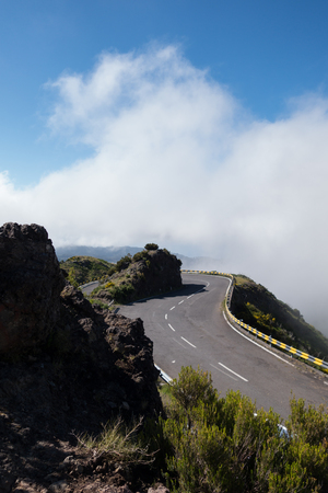 Misty mountain top, Madeira, Portugal, with winding tarmac road Stock fotó
