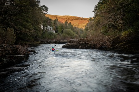 Two people kayaking on the River Dee, Wales