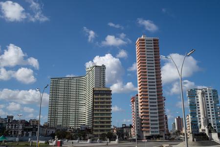 Retro soviet style apartment blocks in the city of Havana, Cuba, with sunny blue skies