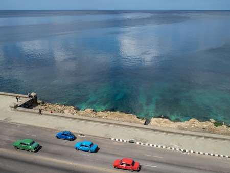 Classic cars driving down the Malcon in Havana, Cuba, aerial view Stock Photo