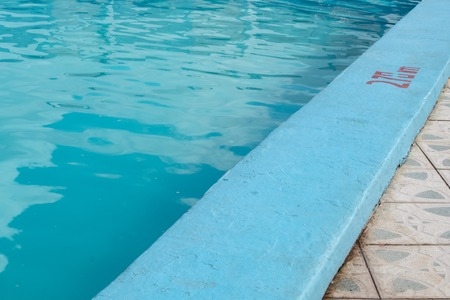 Refreshing cool blue swimming pool, with 2.70m marking Stock Photo