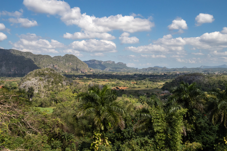 Clouds and blue sky over the tobacco fields and farms of Vinales Valley, Cuba