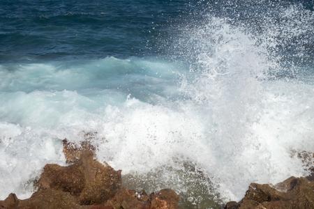 Havana, Cuba, waves crashing over the sea wall and spraying salt water onto the promenade